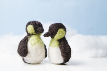 Two felted penguins