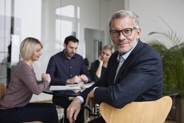 Business people having team meeting in office