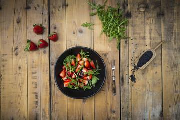 Strawberry rocket beluga lentil salad