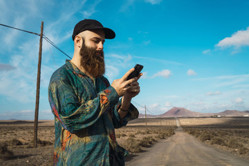 Man with phone on rural road