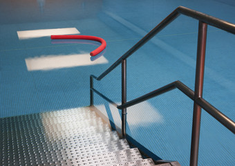 Access to indoor swimming pool with aqua noodle