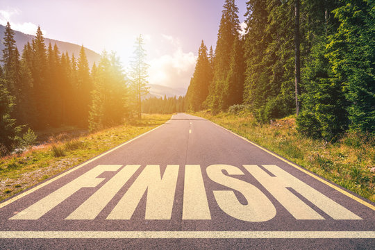 Asphalt road with finish line message.