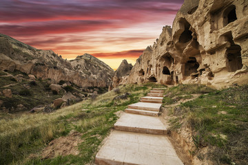sunset of fire on the stone ruins of a city in Cappadocia