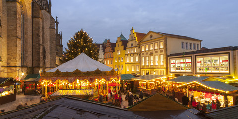Germany, Osnabrueck, Christmas market on market place, gable houses in the evening Wall mural