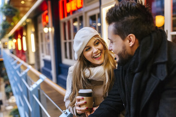Smiling young woman looking at her boyfriend
