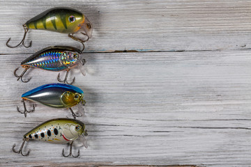 Fishing lures on wooden desk
