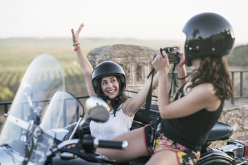 Women on sidecar. Taking pictures in Jaen, Spain.