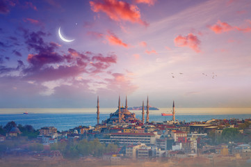 Blue Mosque, glowing sunset with crescent in Istanbul, Turkey