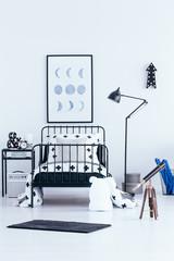 Telescope in kid's bedroom interior
