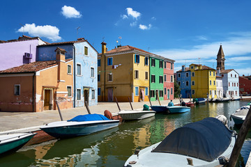 Burano, Venice. Colorful houses architecture, Burano island canal and boats. Summer 2017, Italy