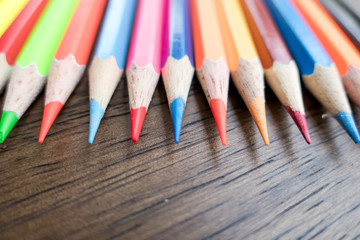 Closeup colorful crayons pencils crayons on wooden table background .