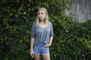Portrait of blond young woman wearing jeans shorts