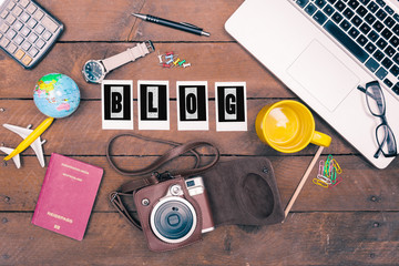 Blog written in instant photo letters on note in travel concept flat lay