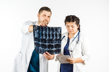 healthcare and medical concept, doctor and student looking at an x-ray. on a white background