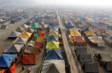 A general view of a giant tent city built for pilgrims attending the Magh Mela, a month-long Hindu festival, on a foggy winter morning in Allahabad