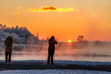 A stunning sunrise view over the extremely cold riverside, Tokachi region, Hokkaido in japan.