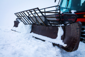 snow-compacting machinery in the fog mountains