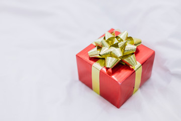 Red gift box with gold ribbon  for special occasions.