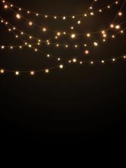 Gold string lights on black background