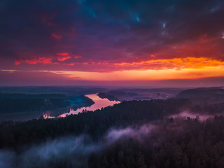 Aerial sunrise or sunset with colorful fog and river
