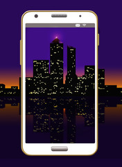 A night time city scape is seen framed by a cell phone in this illustration to go with the idea of taking photos with your phone.