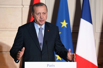 Turkish President Recep Tayyip Erdogan speaks during a joint press conference with the French president at the Elysee Palace in Paris