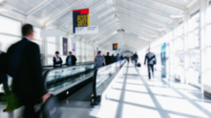 blurred business commuters walking on staircases on a airport