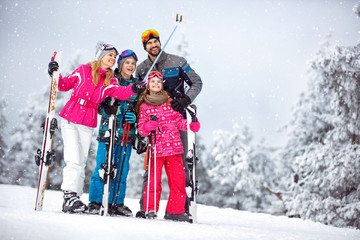 Family making selfie together at snowy mountain