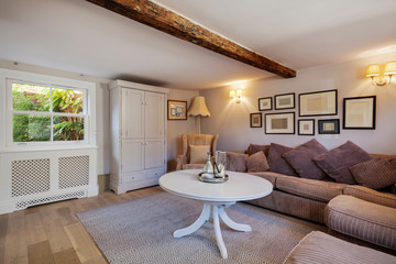 Cottage living room with sofas and picture frames