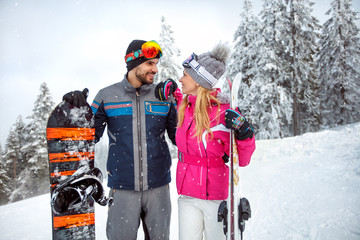 Happy couple on winter holiday skiing