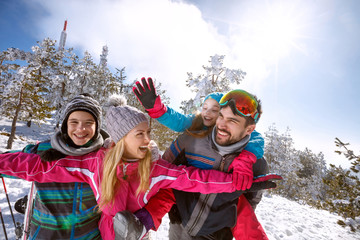 Cheerful family having fun on skiing
