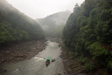 Passenger boat navigating down the Katsura River, Kyoto, Japan