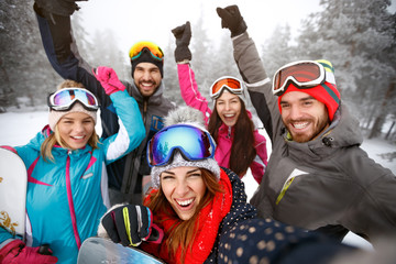 Cheerful skiers on skiing together
