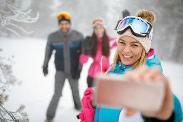 Female making selfie on skiing