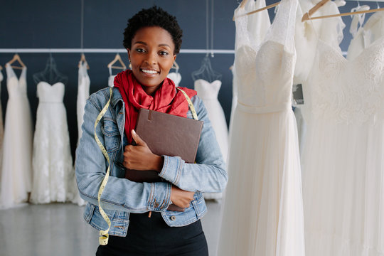 Wedding dress store owner with a diary