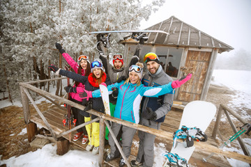 Group of skiers in winter wooden house