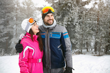 Skiers couple in love in mountain on skiing