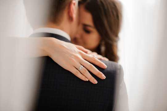 bride demonstrates her elegant diamond engagement ring