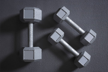 Dumbbells on grey background