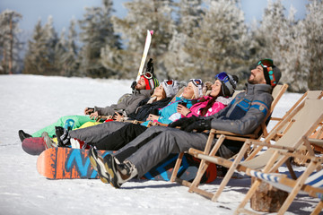 Skiers sunbathing in sunbed
