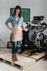 Letterpress artist in her studio