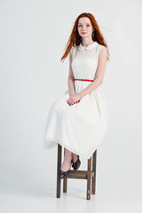 Red-haired girl in a white dress