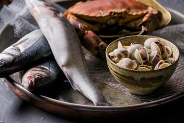 Fresh seafood on a metal tray.