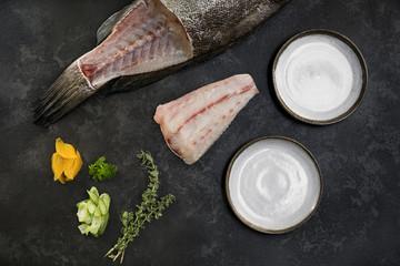 Ingredients for raw grouper fish crudo next to ceramic plates