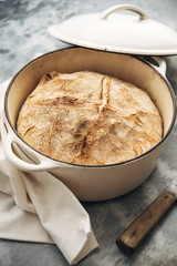 Food: Loaf of white wheat bread baked in an iron cast pot