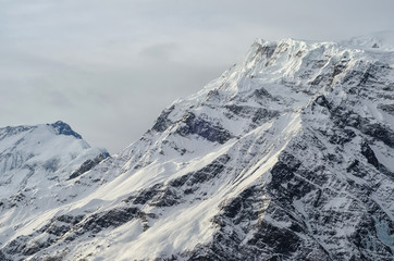 Gorgeous Snowy Mountain Peak of Himalayas in a Dim Evening Light