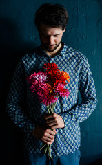Man holding colorful flower bouquet