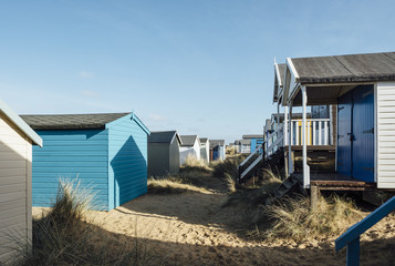 Beach huts in the sand dunes at Old Hunstanton, Norfolk, UK.