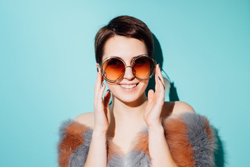 Beautiful Young Woman In Fake Fur Having Fun