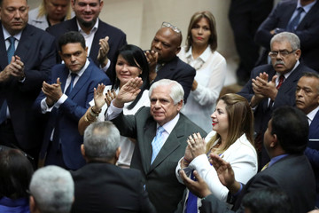 Omar Barboza, lawmaker of the Venezuelan coalition of opposition parties (MUD), gestures during a session of the National Assembly in Caracas